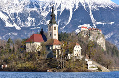 Lake Bled, Slovenia. Lake Bled with island, church, castle and mountains in the background Stock Images