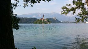 Lake Bled, Slovenia. Lake Bled is in the Julian Alps of the Upper Carniolan region of northwestern Slovenia. The lake is of mixed glacial and tectonic origins Stock Photos