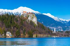 Lake Bled in Slovenia. Old medieval castle on the rock, Slovenia. Lake Bled in Slovenia. Old medieval castle on the rock, snowy mountains and the blue sky on the Stock Photos