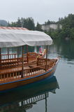 Lake Bled, Slovenia. Pletna Boats provide the foreground for the former summer home of Marshall Tito in what is now Slovenia Royalty Free Stock Photos