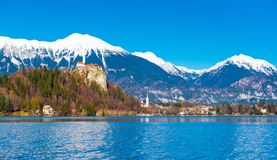Lake Bled in Slovenia. Snowy mountains with clear blue sky on the background Stock Photo