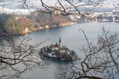 Framed in tree photo of Lake Bled with St. Marys Church of the Assumption on the small island Bled, Slovenia, Europe stock image