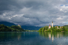 Lake Bled, view of the castle and church in stormy weather with sunshine after rain. Lake Bled, overlooking the castle and church in stormy weather with sunshine Stock Images