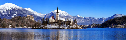 Lake Bled in winter, Bled, Slovenia, Europe. Travel Slovenia, Europe. Winter landscape Bled Lake. Bled Lake one of most amazing tourist attractions. View on Stock Photos