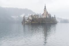Lake Bled in winter mist Stock Photos