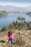 Lake Bled and woman picking flowers Royalty Free Stock Images