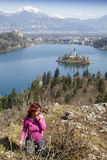 Lake Bled and woman picking flowers Royalty Free Stock Photography
