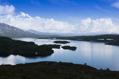 Lake blu sky. Calm lake under a blue sky in the mountains Stock Images