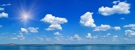 Lake and blue cloudy sky Royalty Free Stock Photos