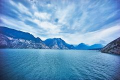 Lake with blue mountains and sky Stock Photography