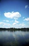 Lake and blue sky. Lake, tree line and blue sky w Stock Image
