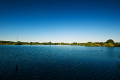 Lake and blue sky. The picture shows a lake and a blue sky royalty free stock photography