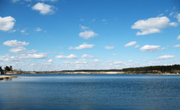Lake. With blue water and blue sky with clouds Stock Photos