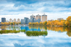 Lake with blue water and high buildings Royalty Free Stock Image