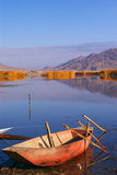 Lake with a boat Stock Photography