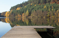 Lake with boat dock. In the autumn Stock Image