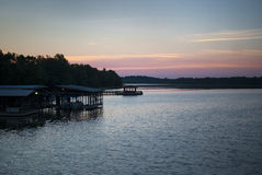 Lake and boat dock at sunrise Stock Photography