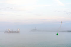 Lake boat engulfed with fog. Horizontal view of a commercial boa. T leaving the harbor, early in the morning Stock Images