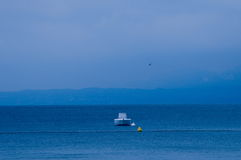 Lake with boat. And gull in the horizon Royalty Free Stock Photo