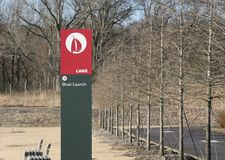 Lake and Boat Launch Sign. A marker points to an area where boats, kayakers and swimmers can enter the lake Stock Images