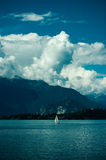 Lake. Boat in a lake with mountains Stock Photography