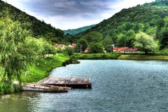 Lake. With boat and pontoon in the mountains Stock Images