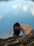Lake boat. Wooden boat on the lake. Calm water, dock Stock Photography