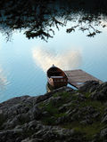 Lake boat. Wooden boat on the lake. Calm water, dock Stock Image