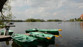 Lake with boats and historical castle Trakai panorama. Lithuania stock footage