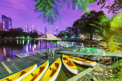 Lake with boats in Lumphini park Royalty Free Stock Photography