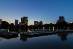 Lake with boats in Lumphini park. At night.ฺBangkok THAILAND stock photography