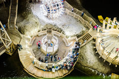 Lake and boats in the salt mine Turda, Cluj, Romania. Futuristic wooden structures royalty free stock photo
