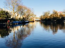 The little Venice in London. Lake, boats, trees, blue sky, nature, reflection, clear water, blue water are the words that describe this landscape royalty free stock images