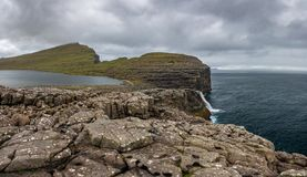 Bosdalafossur waterfall and coastline, Faroe Islands