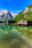 Lake Braies also known as Pragser Wildsee  in beautiful mountain landscape. Relaxing and recreation at Lago di Braies in Dolomites royalty free stock photos