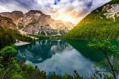 Lake Braies also known as Pragser Wildsee  in beautiful mountain landscape. Sun and cloud scenery at sunset time. Amazing Travel royalty free stock photo