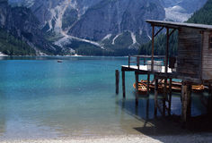 Lake of Braies, in Dobbiaco, Italy. Overview of the Lake of Braies, in Dobbiaco, Italy, with wooden bungalow on pile and some boats Stock Images