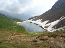 Lake Branchino an Alpine natural lake during spring season. Orobie Alps. Italian Alps. Lombardy. Italy. Lake Branchino an Alpine natural lake during spring royalty free stock photos