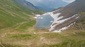 Lake Branchino an Alpine natural lake during spring season. Orobie Alps. Italian Alps. Lombardy. Italy royalty free stock photography