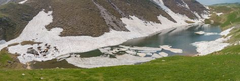Lake Branchino an Alpine natural lake during spring season. Orobie Alps. Italian Alps. Lombardy. Italy stock photography