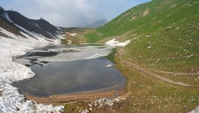 Lake Branchino an Alpine natural lake during spring season. Orobie Alps. Italian Alps. Lombardy. Italy stock photo