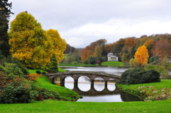 Lake and Bridge in Autumn - Stourhead Garden Royalty Free Stock Photo