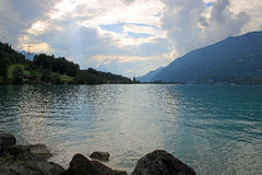 Sunset at lake in Switzerland with surrounding mountains. Royalty Free Stock Photos