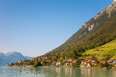Lake Brienz with village. Lake Brienz, village in Switzerland Stock Photos