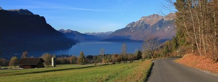Lake Brienzersee and mount Augstmatthorn. View from Brienz, Swit. Autumn scene in Brienz. Green meadow, houses and lake Brienzersee. Mount Augstmatthorn Royalty Free Stock Images
