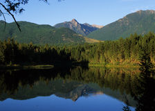 Lake in British Columbia. Mountains reflected in a small lake in British Columbia, Canada Royalty Free Stock Images