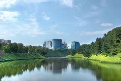 Lake with buildings Stock Photography