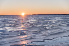 Lake Butte des Morts Ice Sunset. Sunset over a frozen Lake Butte des Morts.  Photographed from the dock at the boat launch in the Town of Butte des Morts Royalty Free Stock Photo