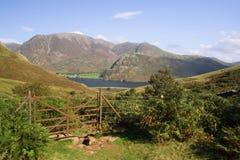 Lake Buttermere,Lake District,Uk. Rusty gate leading to Lake Buttermere,Lake District,Uk Royalty Free Stock Photo