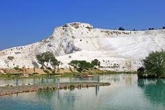 Lake and calcified limestone terraces on background, Pamukkale Royalty Free Stock Photos